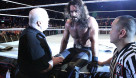 Current champion Seth Rollins being checked for injury following a match in Dublin, Ireland. / credit: wwe.com