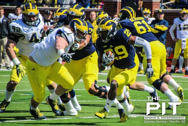 Junior CB Ross Taylor-Douglas races into a fierce Michigan defense to gain just 5 yards during Saturday's spring game at the Big House. Photo/Damien Dennis